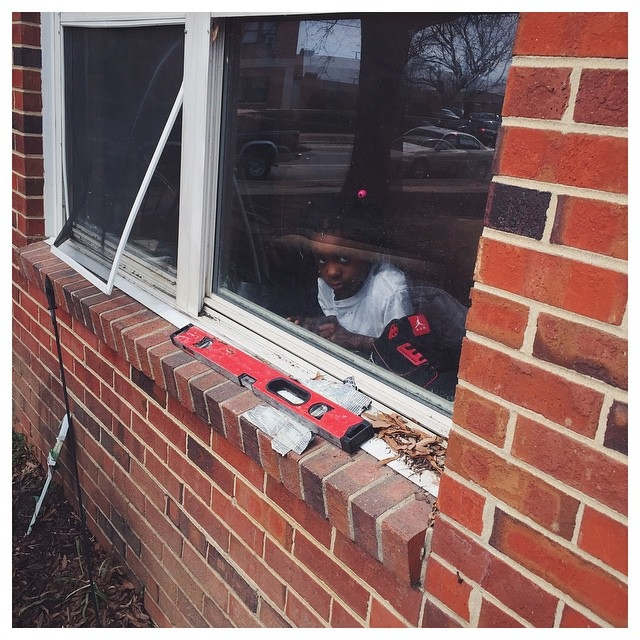 As Joshua leaves the apartment, the young girl looks outside her living room window.