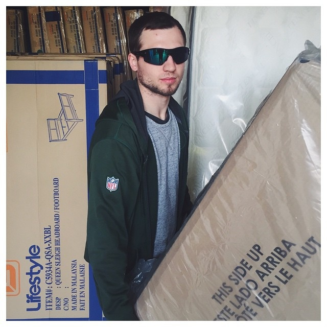Joshua Deane stages a delivery for Atlantic Bedding & Furniture where he works as an independent contractor. The delivery, a sofa/love seat package, is set for an apartment on North Avenue - one of the most heavily populated low-incoming housing areas in Richmond, Virginia.