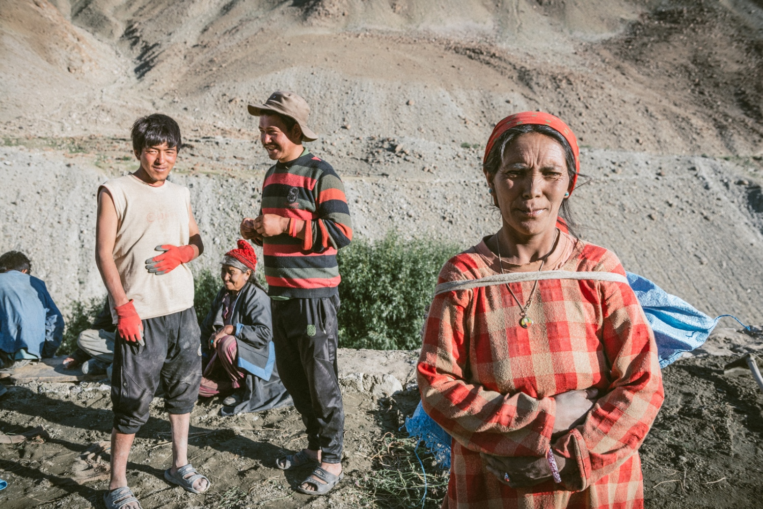 Local residents of Domkhar Gongma village in Ladakh gather together to build a traditionally designed home on the cliff side.
