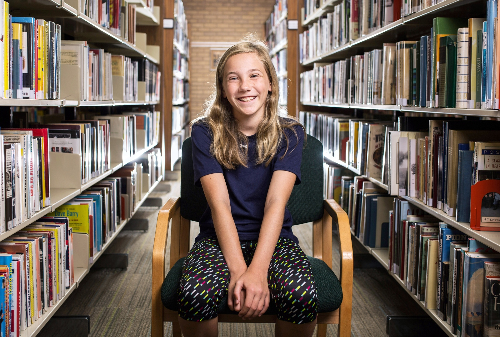 "Caroline Auge, 10: ""I like reading the Warriors series. They're about cats — they have to try to survive in the winter, fall, spring and summer. They have to work together. They have to fight against the rogue cats and strive for food. I think people should go to the library a lot because it's a place where you can learn about a lot of things and have fun."""