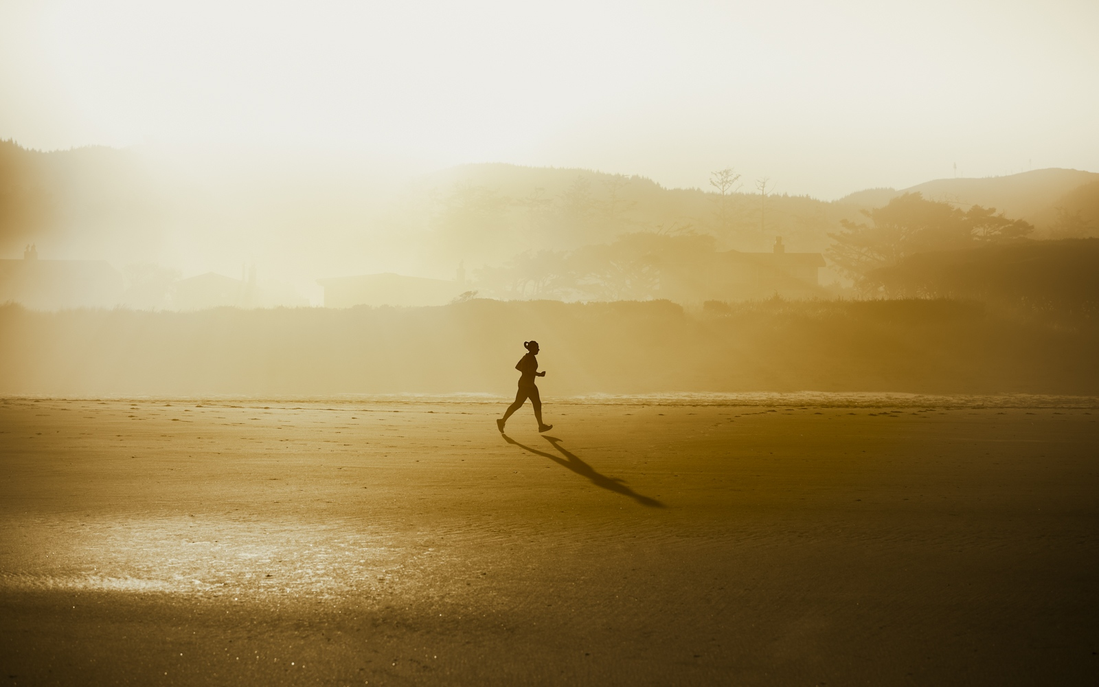 Early morning runner on the beach •...