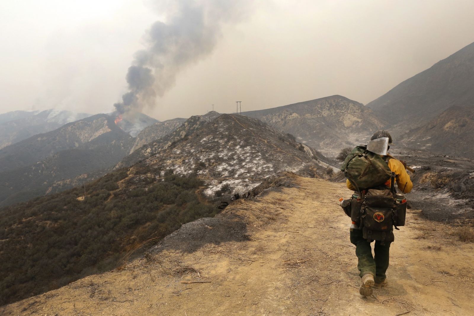 Angeles National Forest firefighter Simeon Hagens walks along a trail already burned by the Sand Fire near Wildlife Waystation on Little Tujunga Canyon Road on Saturday, July 23, 2016. Katharine Lotze/The Signal