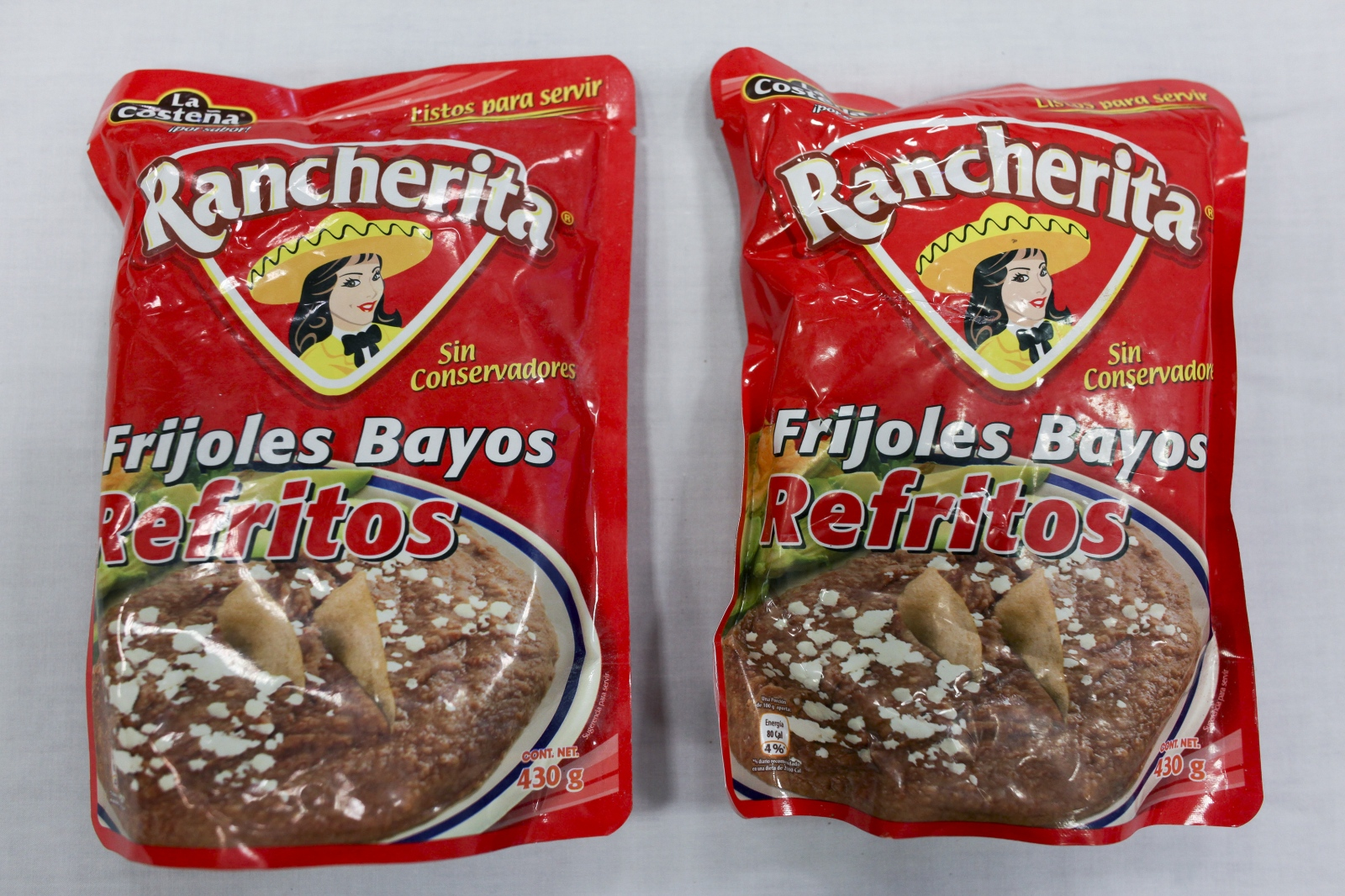 Refried beans, along with other packaged foods are found in the backpack of deceased Mario Velazquez, 32, a migrant border crosser at the Pima County Office of the Medical Examiner on May 22, 2013, in Tucson, Ariz.