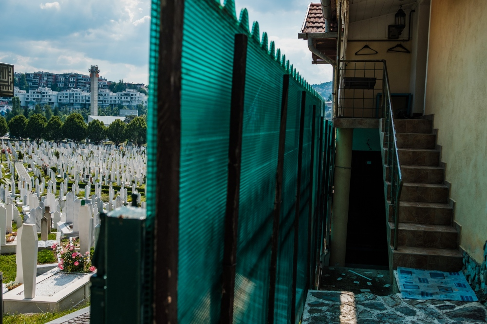 The Sarajevo landscape is pockmarked with cemeteries both big and small. A constant reminder of the nearly 14,000 people killed over a three-year period. Here, the Mezarje Stadion Cemetery butts right up against houses.