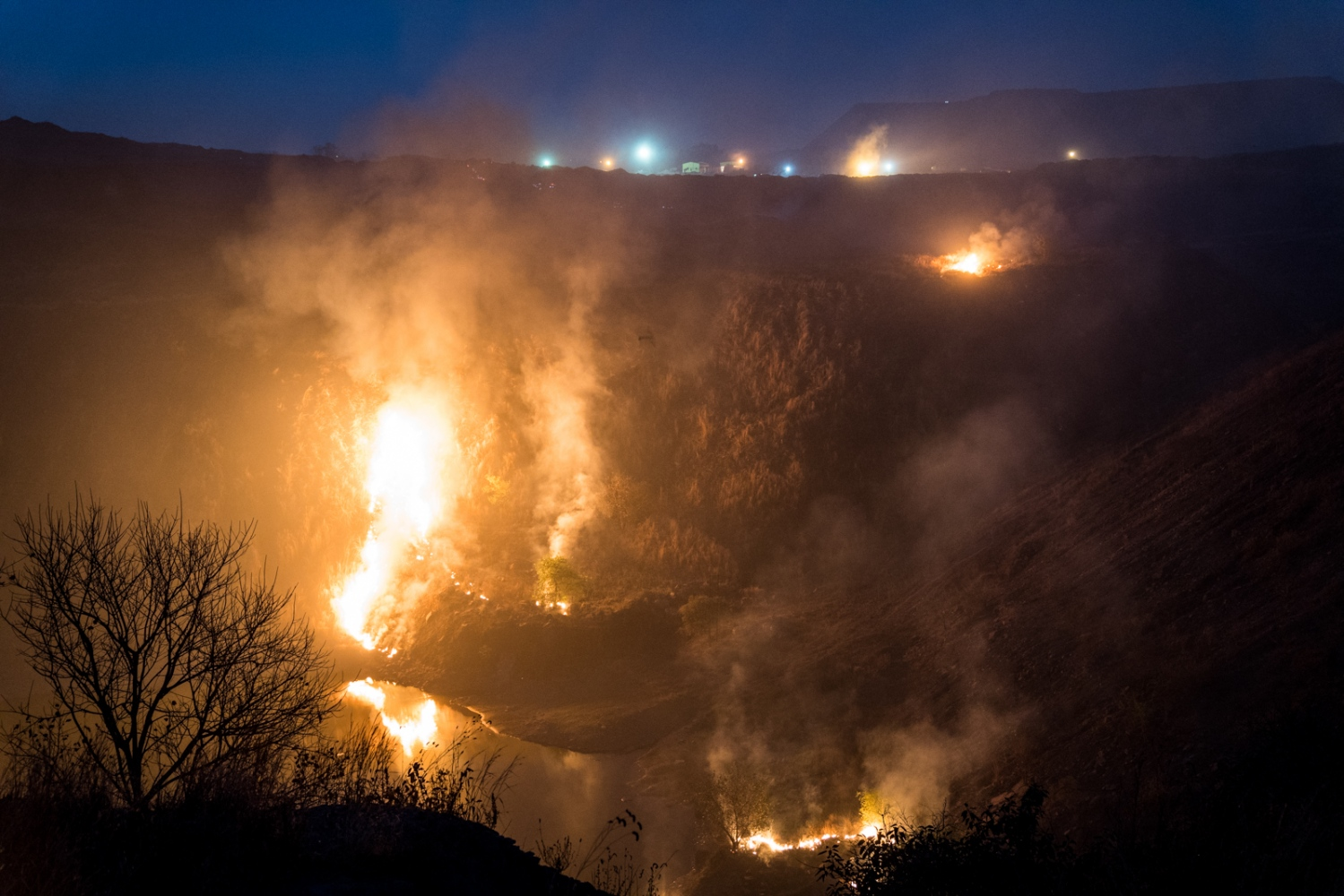A coal mine on fire in Jharia releasing vast amounts of dangerous gases and particulates.