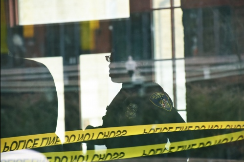 Baltimore- An officer invesitgates a shooting at a popular Baltimore cafe