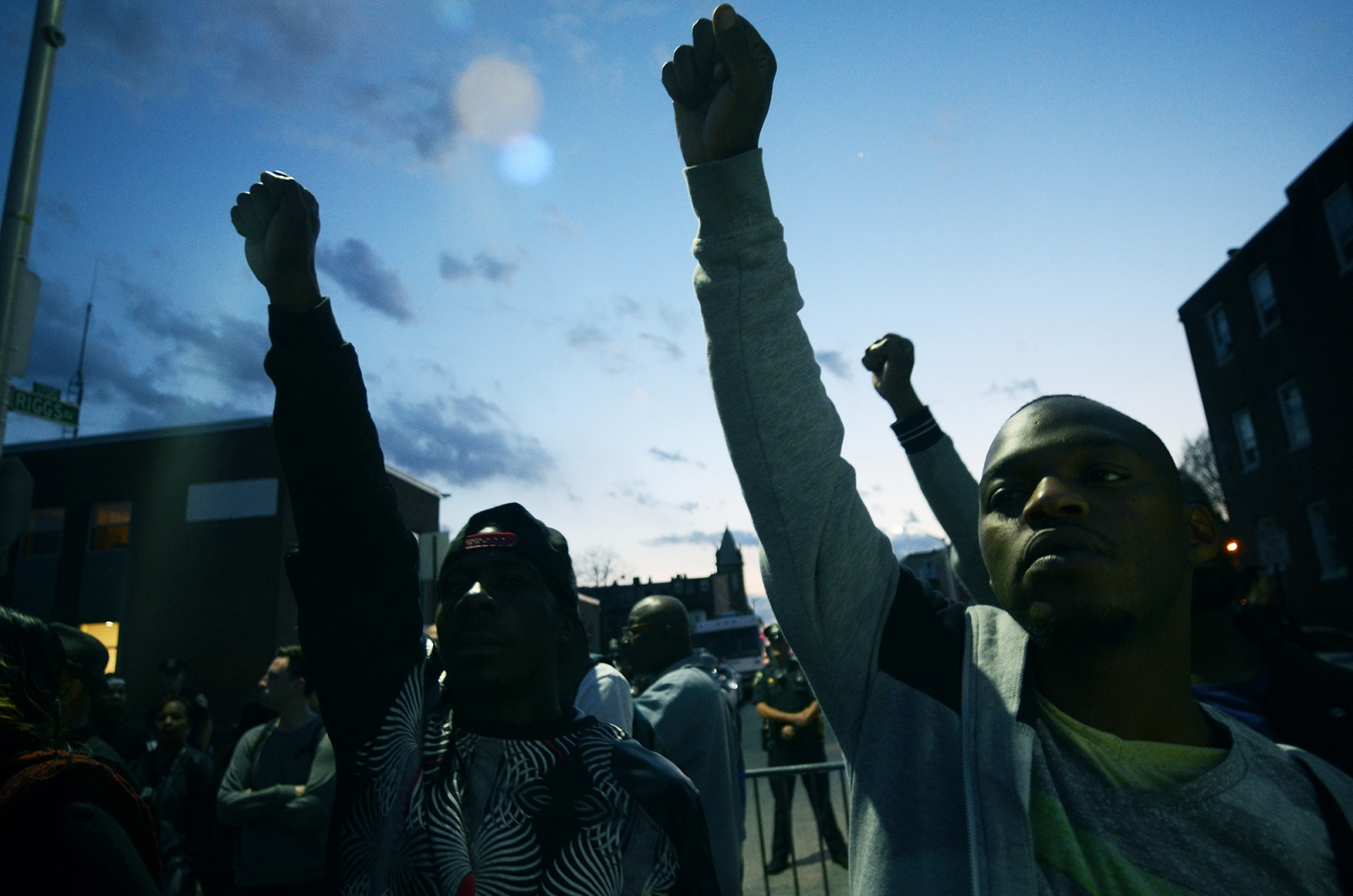 Baltimore- Men protesting the death of Freddie Gray while in police custody raise their fists during a rally at the city's Western District