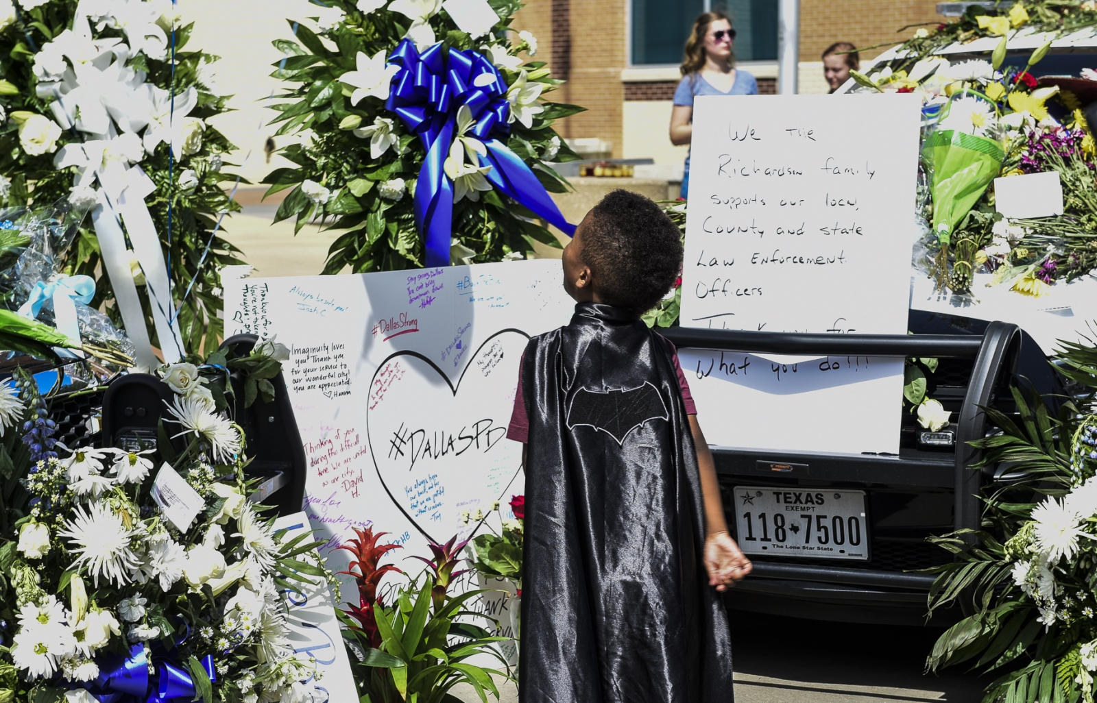 Dallas- A young boy at the vigil site for the seven officers shot and killed in Dallas