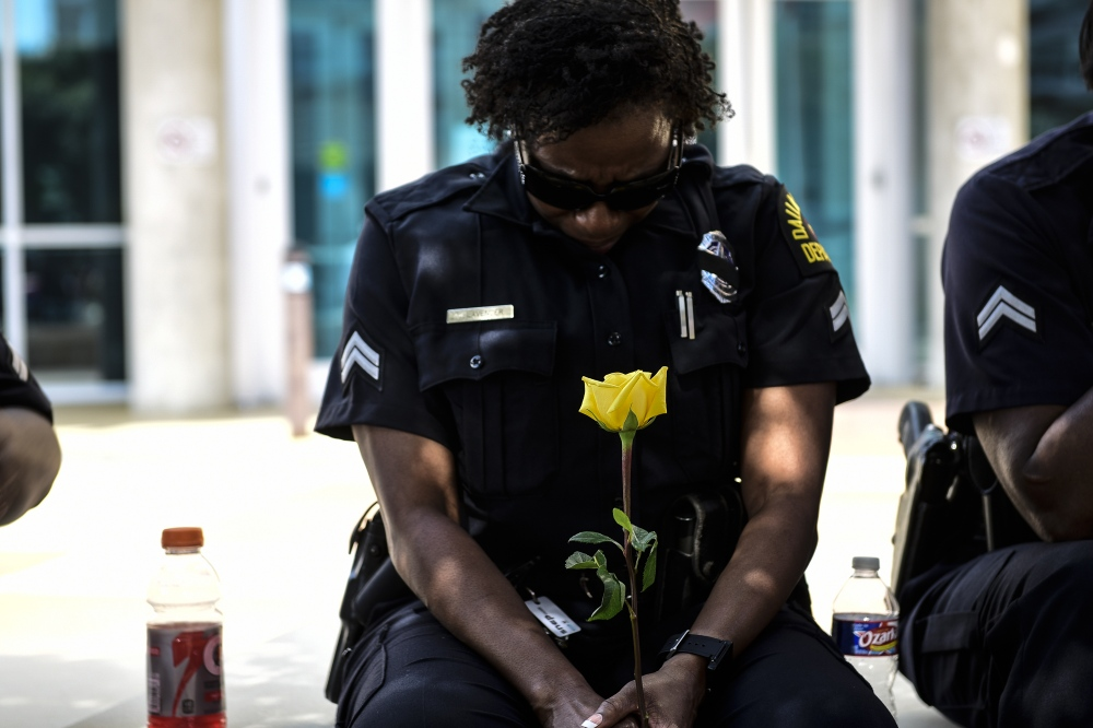 Dallas- A Dallas police officer mourns the death of her fellow officers