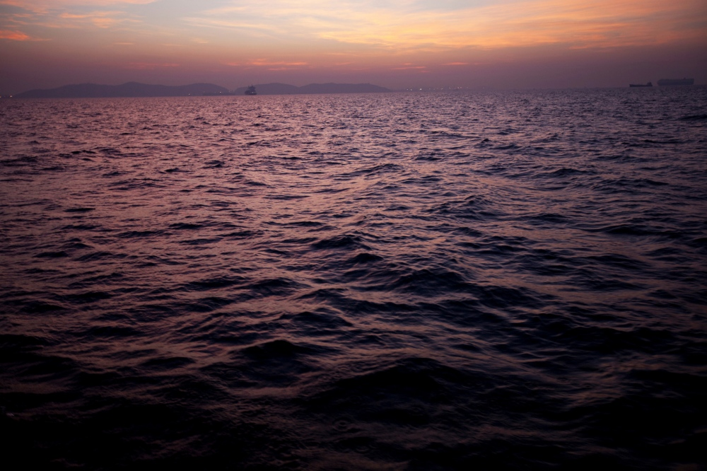 The Gulf of Thailand at dawn seen from a fishing trawler as it returns to shore. Rayong, Thailand