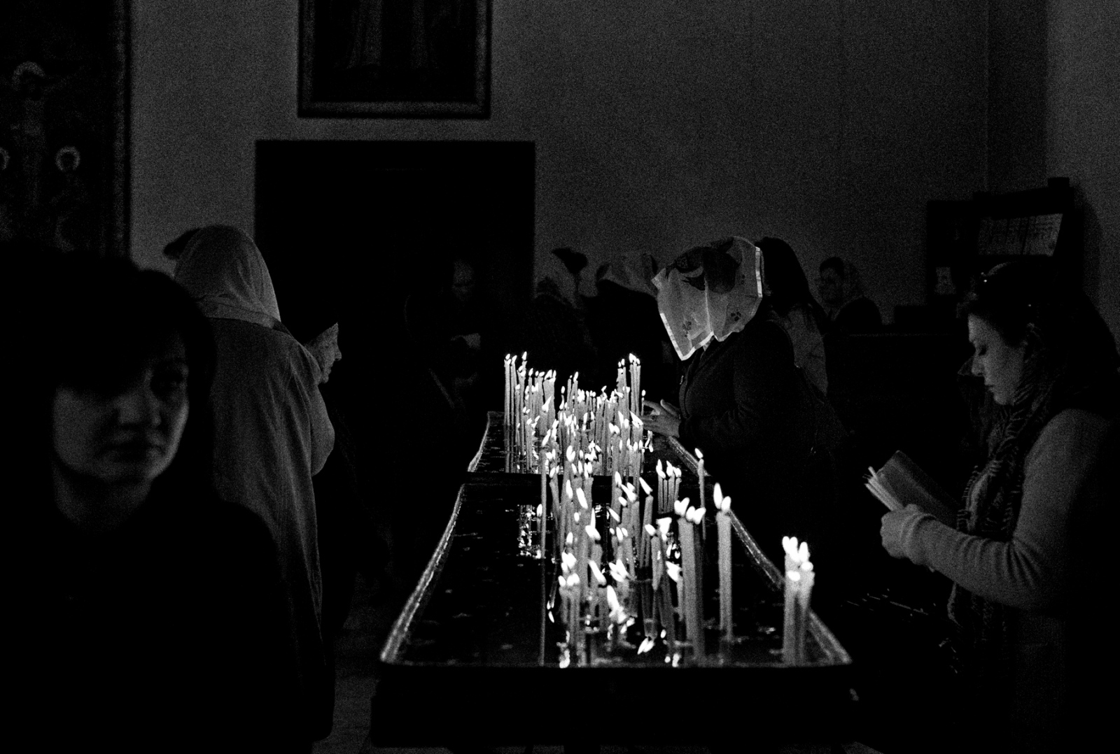 Worshipers pray and light candles at the Etchmiadzin Cathedral in Vagharshapat, Armenia. The original church was built between 301 and 303. Following the invasion of the Persian Empire, the Church was heavily damaged and so it was rebuilt in 483. The Cathedral is the main shrine of religious Christian Armenians worldwide and was listed as a World Heritage Site by UNESCO in 2000.