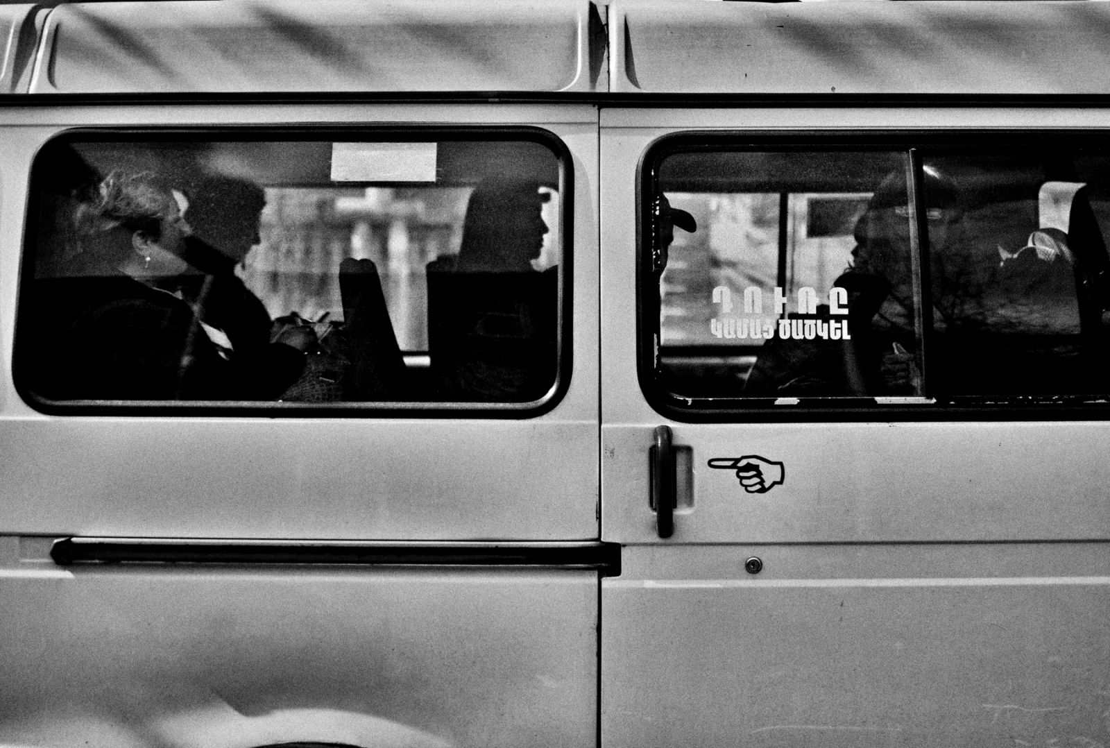 Passengers in a small commercial van that serves as a neighborhood bus in the Capital City of Yerevan, Armenia.