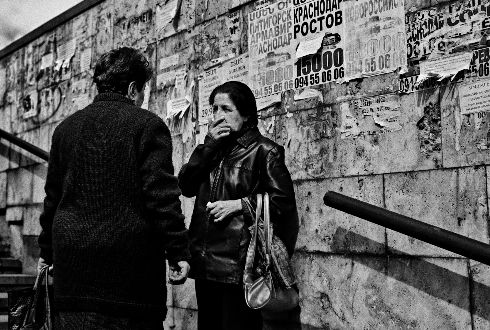 Two women have a conversation on the stairs leading to an underground pedestrian passage in the Capital City of Yerevan, Armenia.