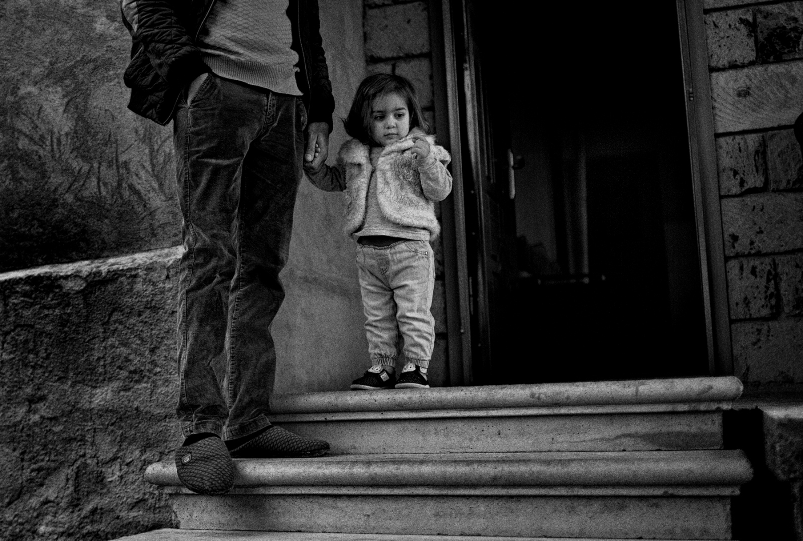 A young girl and her father in front of their home in Ashtarak, Armenia.