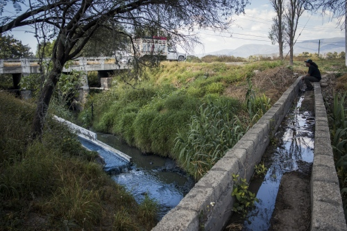 Martin Barrios, environmental activist, watch at the discharge canal of Lavasport laundry, one of the main factories who produces denim in Tehuacan.