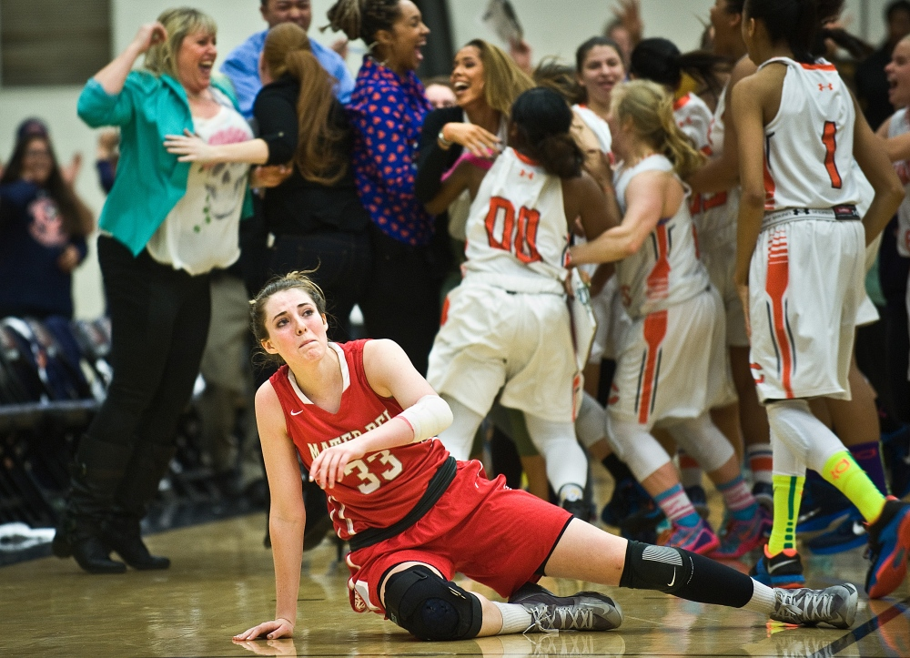 Mater Dei senior Katie Lou Samuelson lifts herself up as Chaminade celebrates their victory over Mater Dei during the CIF-SS Open Division finals game at Azusa Pacific University. Mater Dei lost 64-63. Samuelson was named Gatorade's national girl's basketball player of the year in 2015.