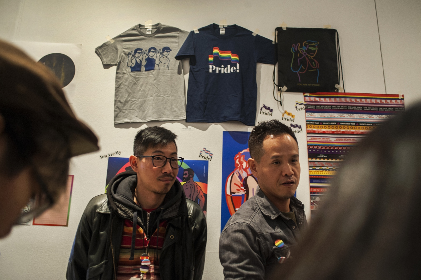"""Jeon (left)'s artwork often appears on posters, t-shirts, queer publications, badges, anything and everything to raise visual awareness of queer issues and identity in Korea. Above, he is pictured at the Northern Seoul Museum of Art for an annual art book fair called """"Unlimited Edition"""" with his partner Hyung-joo Kim, 40, selling pride merchandise and a queer publication he designed, called Flag."""