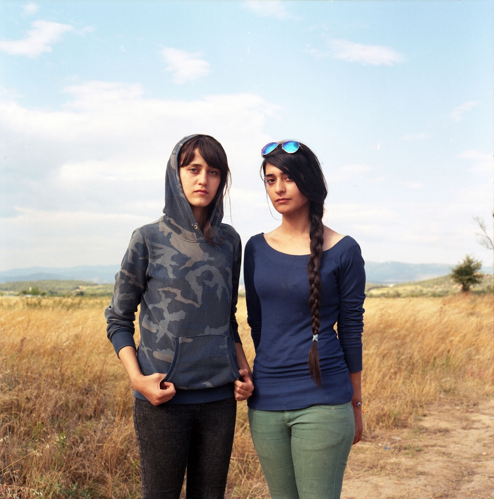 Hevin Osman and her friend, refugees from Aleppo, Syria camped for four days in the fields of Idomeni by the Greek-Macedonian border waiting for a chance to cross.