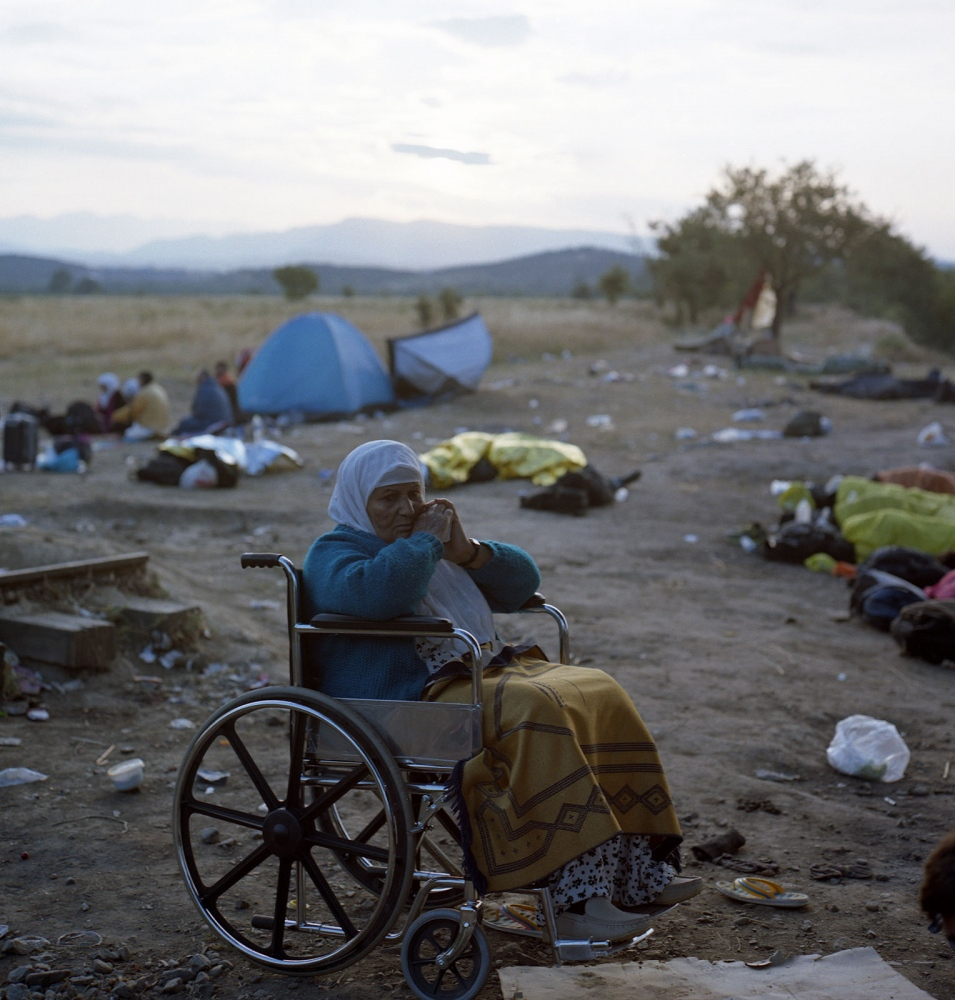 Syrian refugee waiting in the fields in Idomeni for a chance to cross. According to International Migration Organization, in the first six months of 2015 around 59,000 refugees arrived in Greece, 21,000 of which were from Syria.