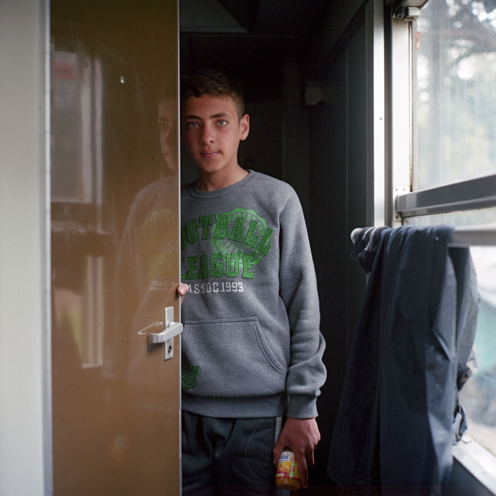 Basel, a fifteen year-old schoolboy from Idlib, Syria. He and his family camped in Idomeni for a month in March 2016. Initially they lived in a tent, but it became unbearable with rain, mud and wind. They were able to relocate inside the train compartments donated by the Greek government.