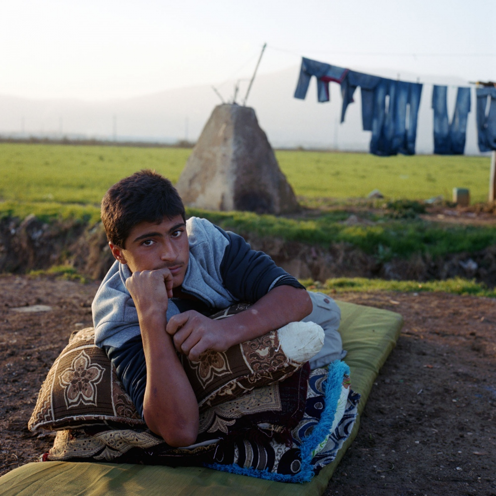 Mohamed, a fifteen year old refugee from Homs outside the informal settlement on the premises of an abandoned onion factory in the Beqaa Valley of Lebanon.