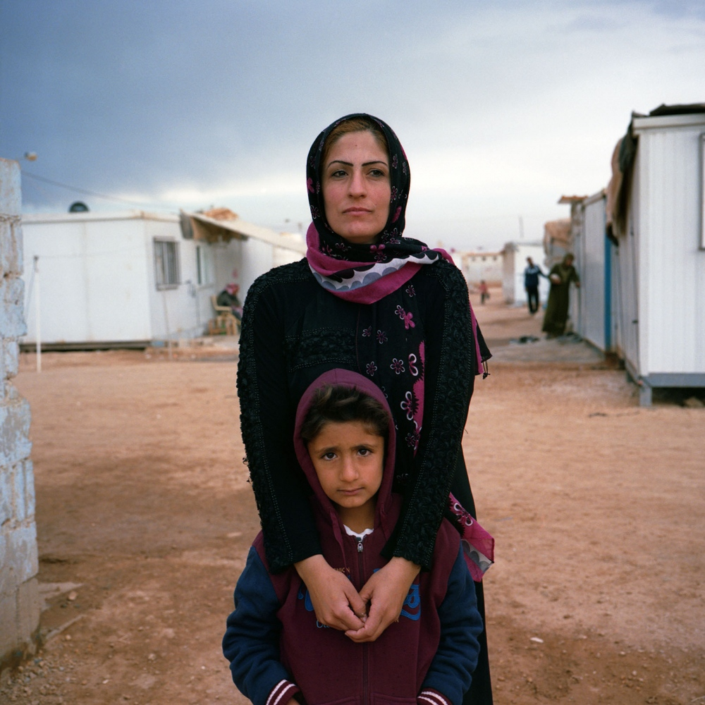 """Syrian schoolteacher Amal Hourani's adjustment to life in the Zaatari refugee camp in Jordan has not been easy, she said: """"I refused to carry water from the distribution point, or to wait in line for food handouts. I refused to wash laundry with my bare hands. Back home I used a washing machine. I said to myself, I will not let this situation and our circumstances get the better of me, I will beat it. I will be stronger than that."""""""