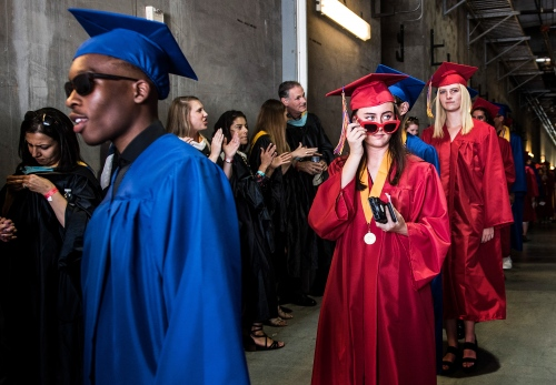 Los Alamitos High School graduates enter the the StubHub Center during the school's graduation ceremony in Carson, California.