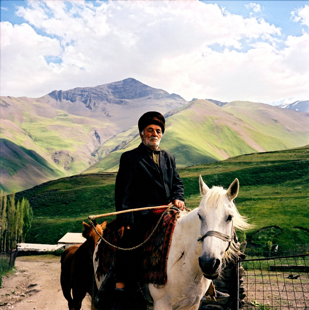 Badal Lalayev, the village postman on horseback. Khinaliq village, Azerbaijan. 2006