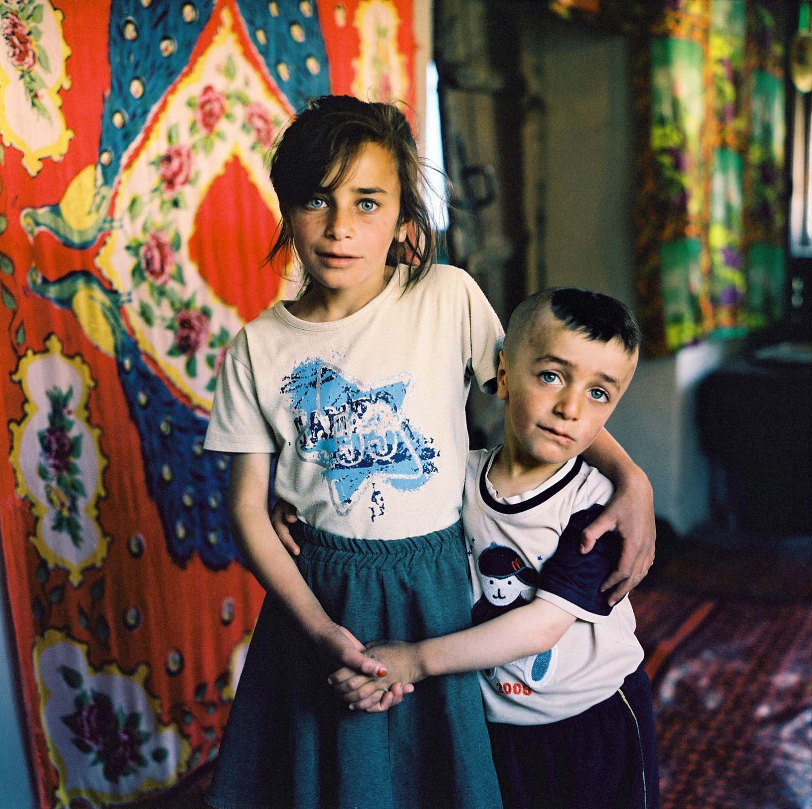 Zulfiya with her little brother at home. Khinaliq village. Azerbaijan. 2006