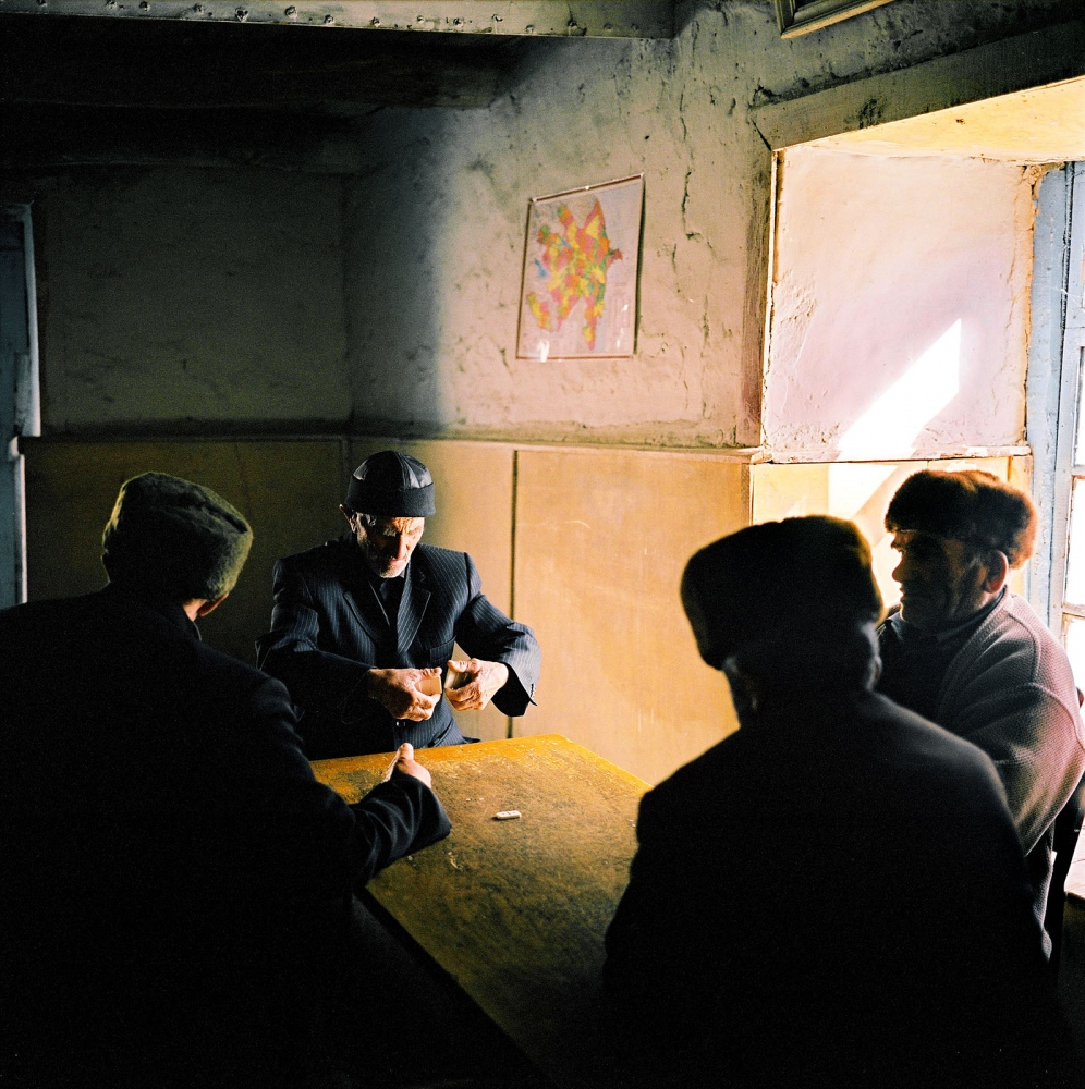 Men playing dominos at the village cultural club in Khinaliq, Azerbaijan. 2006