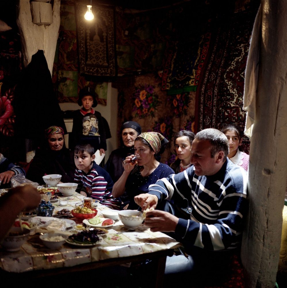 Zulfia's family eating dinner at home in Khinaliq, Azerbaijan. 2009