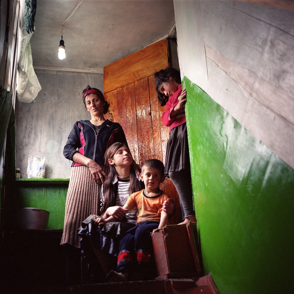 Family at the doorstep of their home. Khinaliq, Azerbaijan. 2009