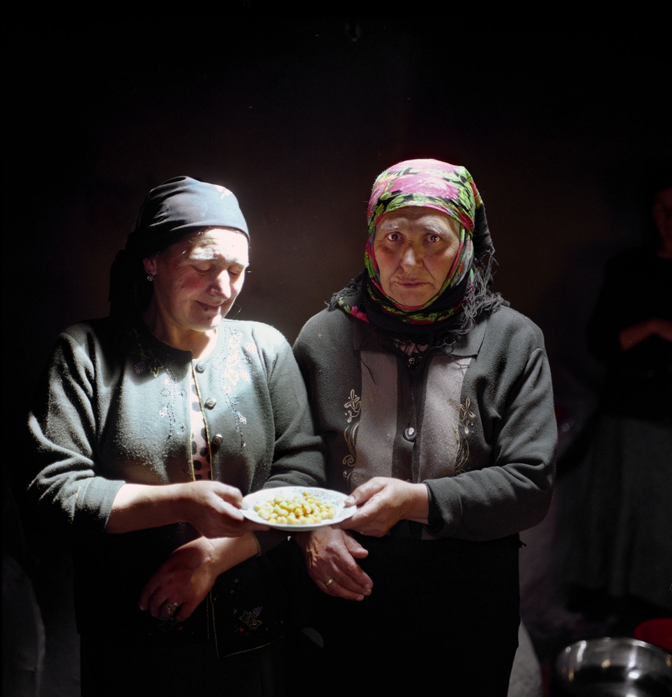 Sisters boiling chickpeas for Tikya Bozbash, a meal of mutton, potatos and vegetables cooked in a broth to be served for the wedding guests in Khinaliq village, Azerbaijan. 2009