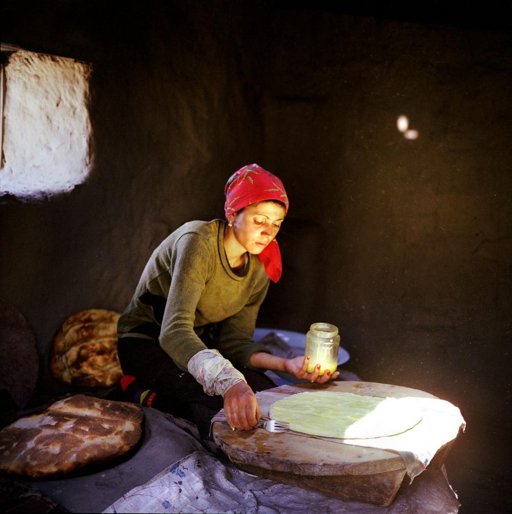 Sadaget baking bread. Khinaliq, Azerbaijan. 2006