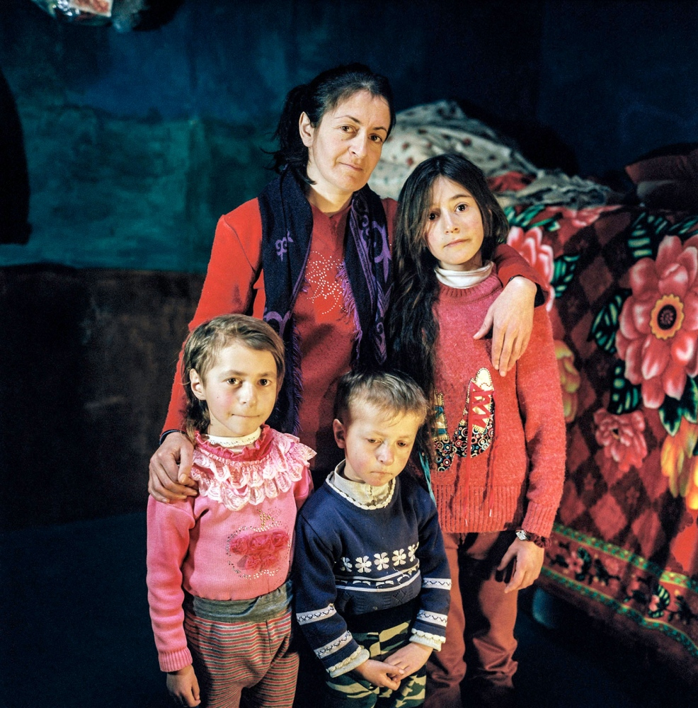 Marjiya with her children Aisha, Lutfana and Yahmour at home. Khinaliq, Azerbaijan. 2018