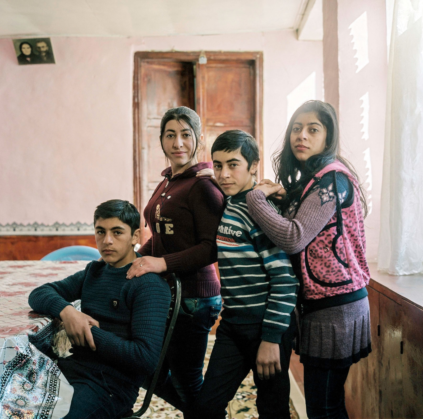Izzet, Hamida, Samir and Maryam at home in Khanilq village. Azerbaijan. 2018
