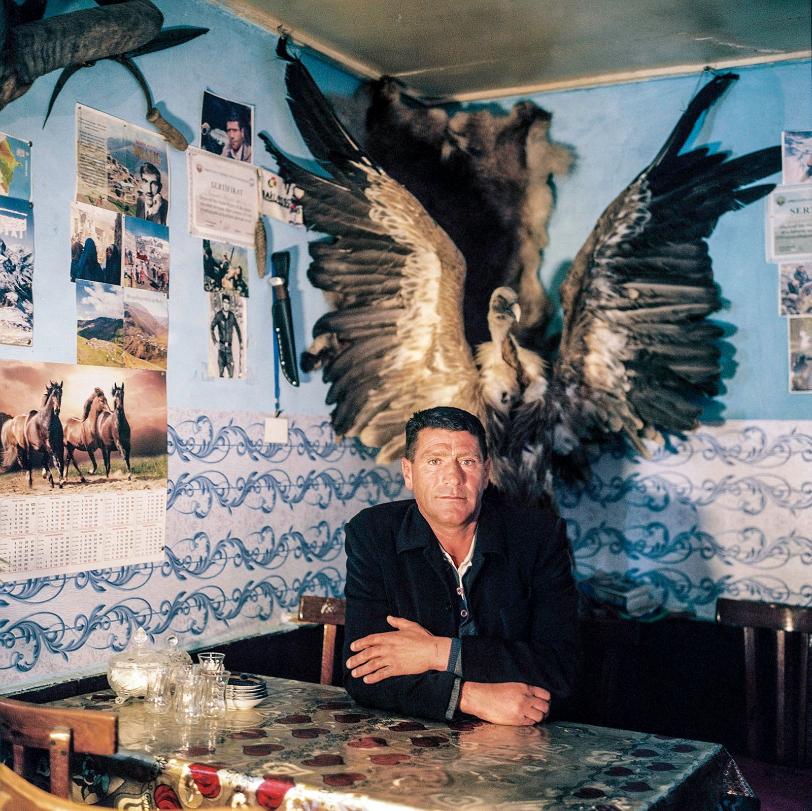 Kabir at home with his hunting trophies. Khinaliq, Azerbaijan. 2018