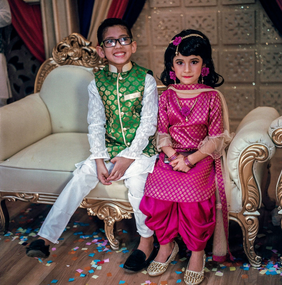 Two young wedding guests pose during Sufia and Ahmed's gaye holud in Dhaka.