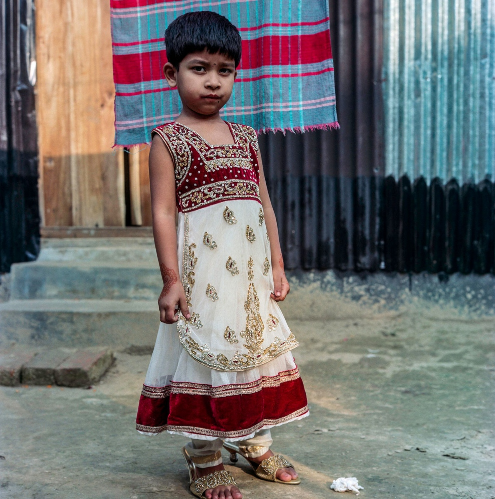 Children wear colorful outfits and sometimes bindis to mark the special occasion of their family celebrating a wedding in Gazipour.