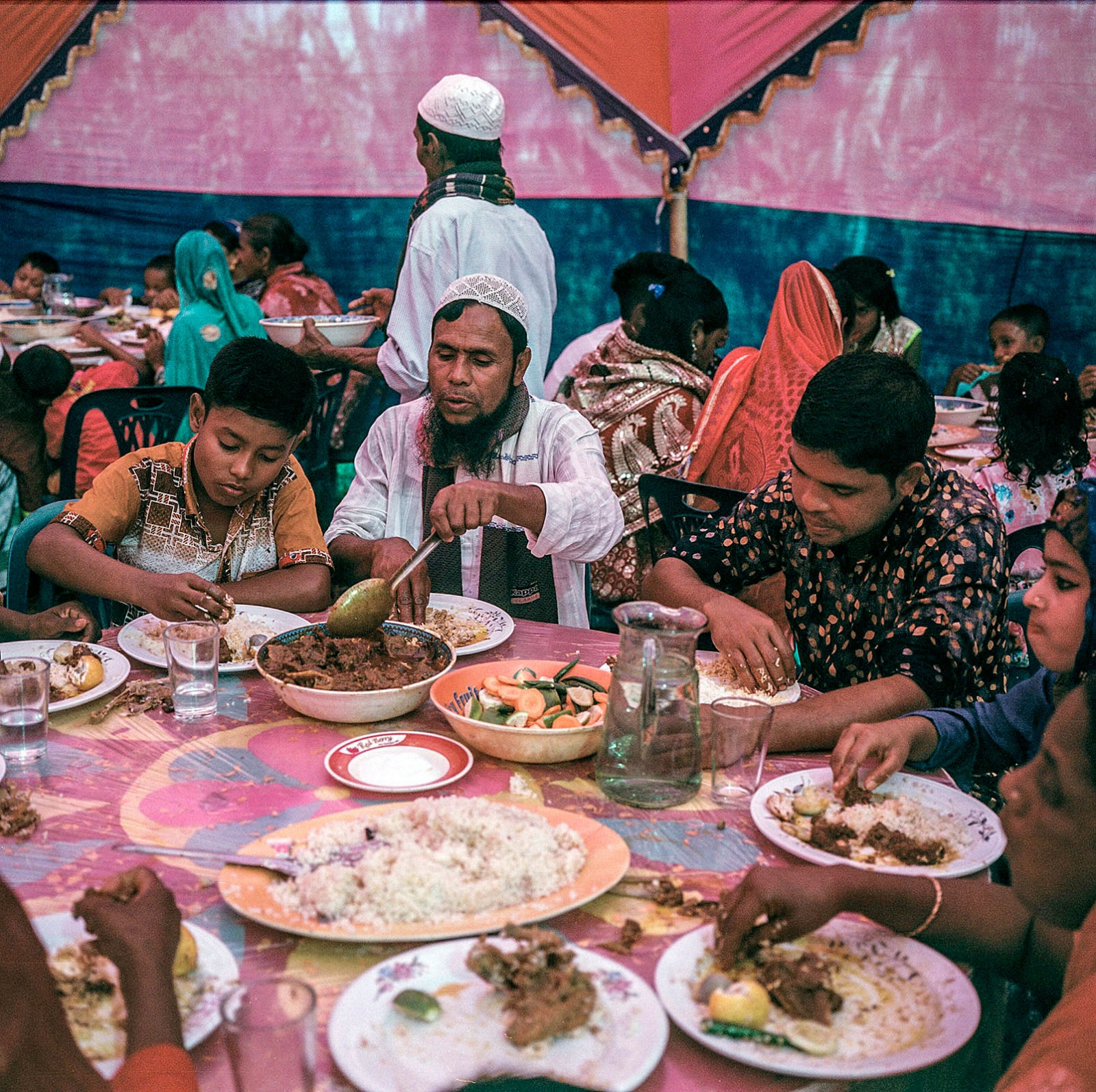 Guests are served chicken roast, mutton buryani and fish curry along with rice and eggs in Manehor, a typical wedding meal spread.