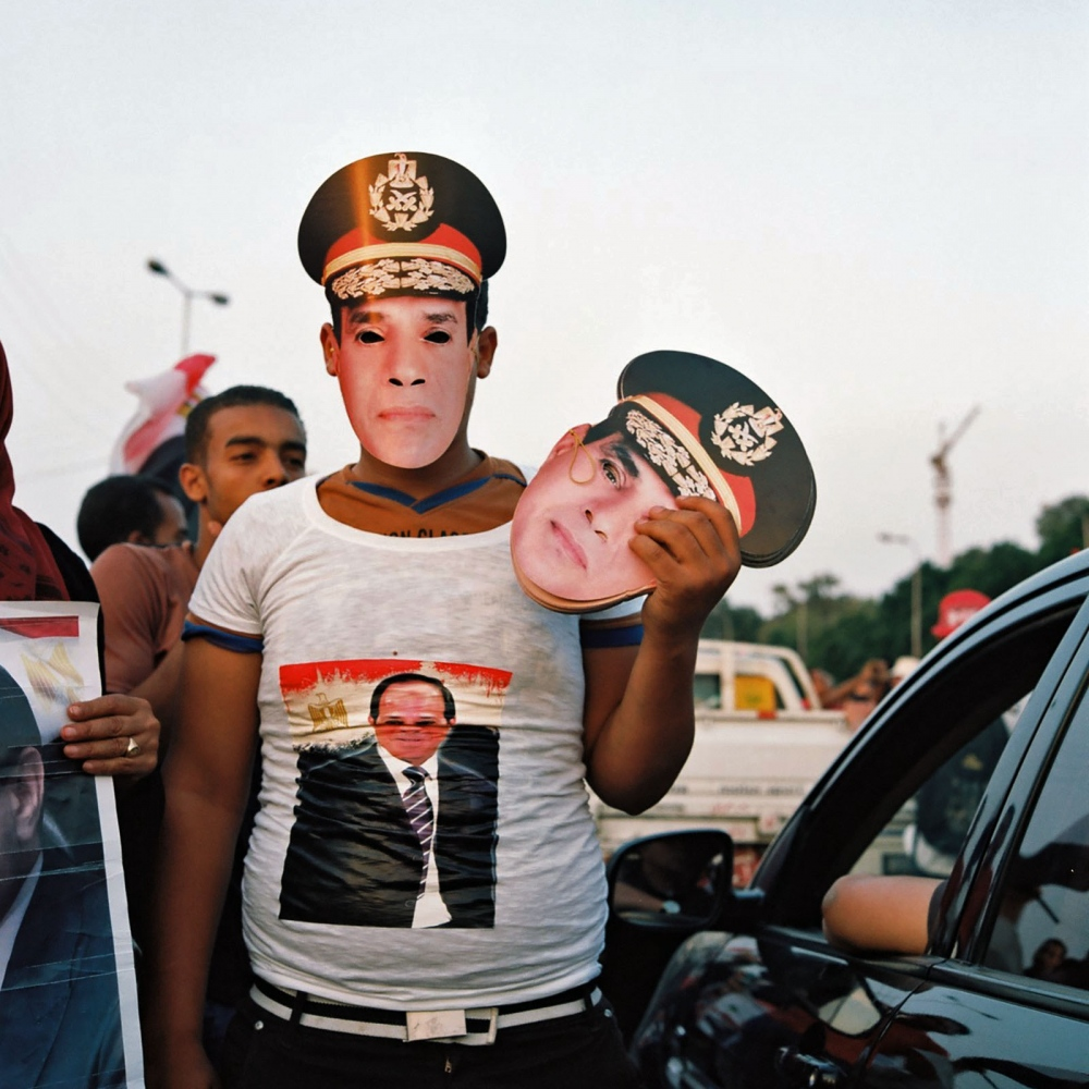 "A Cairo vendor sells masks of Abdel Fattah el-Sisi during Egypt's 2014 presidential election. Having deposed his predecessor in a coup, the popular former general won 97 percent of the vote. After taking office, he announced the construction of a brand-new capital in the desert east of Cairo—a $300 billion project reminiscent of Akhenaten's desert capital at Amarna. ""It's the same back then; it's the same now,"" archaeologist Anna Stevens says. ""Everybody is running after Sisi because he's a strong man."""