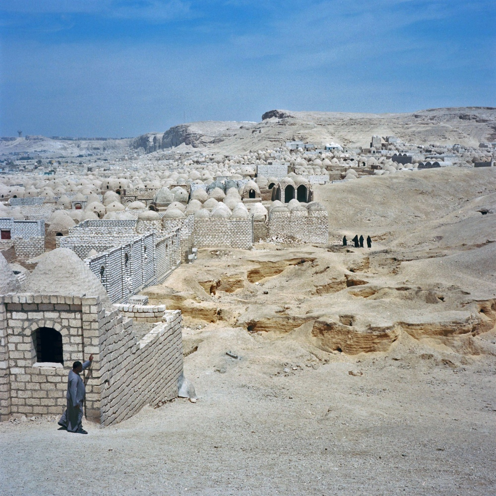 Near the city of Minya, modern Egyptians still honor their dead by building permanent structures—such as a cemetery of domed roofs and limestone walls. At the ancient site of Amarna, the elite prepared elaborate tombs that were carved high into the cliffs east of the city.