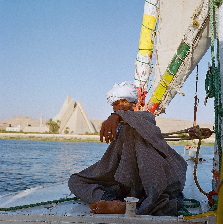 Mamdouh Abu Kelwa sails his felucca past the unfinished Aten Museum in Minya. Akhenaten needed only five years to build a new capital; the 25-acre museum complex has taken more than twice as long because of political and economic instability. Since the project began, Egypt has undergone a revolution and a coup, and two former presidents have been put on trial.