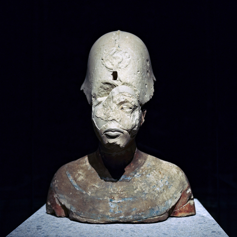In Berlin's Neues Museum, Akhenaten's bust bears the scars of upheavals ancient and modern. Smashed by the king's successors in the 14th century B.C., it was also damaged as a result of being moved during World War II.