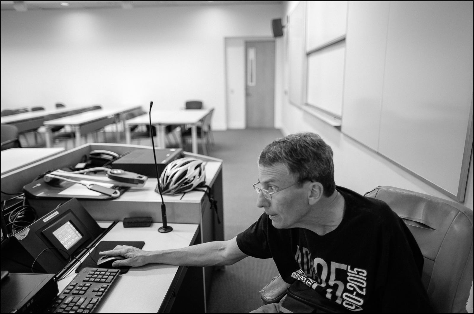 Art Blaser prepares for his Fall 2015 courses by checking the classroom that operates TextAloud, a software that converts screen words into spoken words. Blaser uses assistive technology to teach at Chapman University. July 17, 2015.