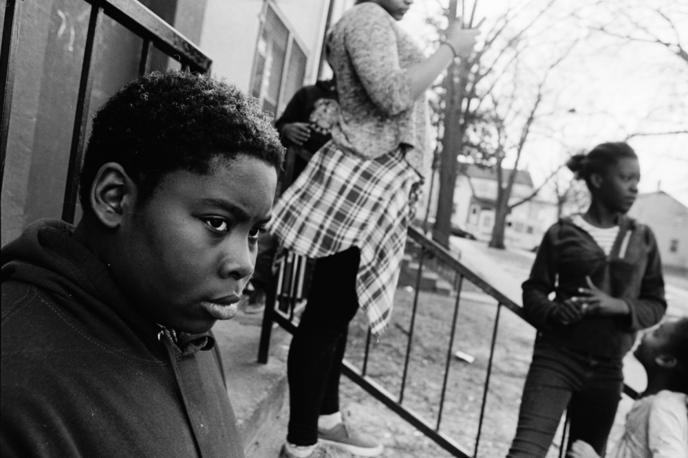 George Weary watches a drug arrest in front of his home. Weary is a third generation Barry Farm resident.