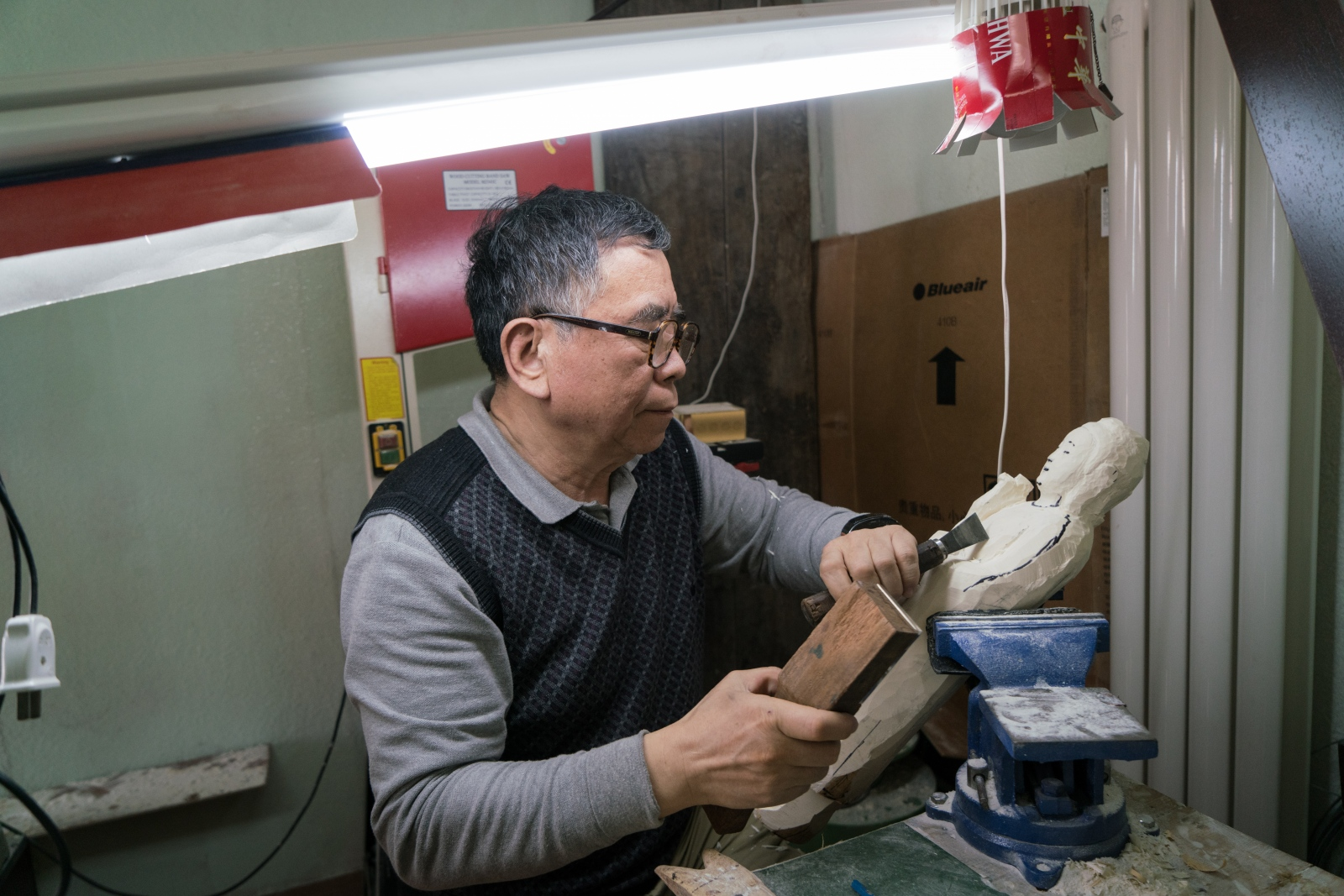 Ivory carving artist Li Chunke works on an ivory Gautama Buddha statue in his ivory workshop in Beijing, China on December 10, 2017. Li has worked as an ivory carving artist since 1964 when he was 15 years old.