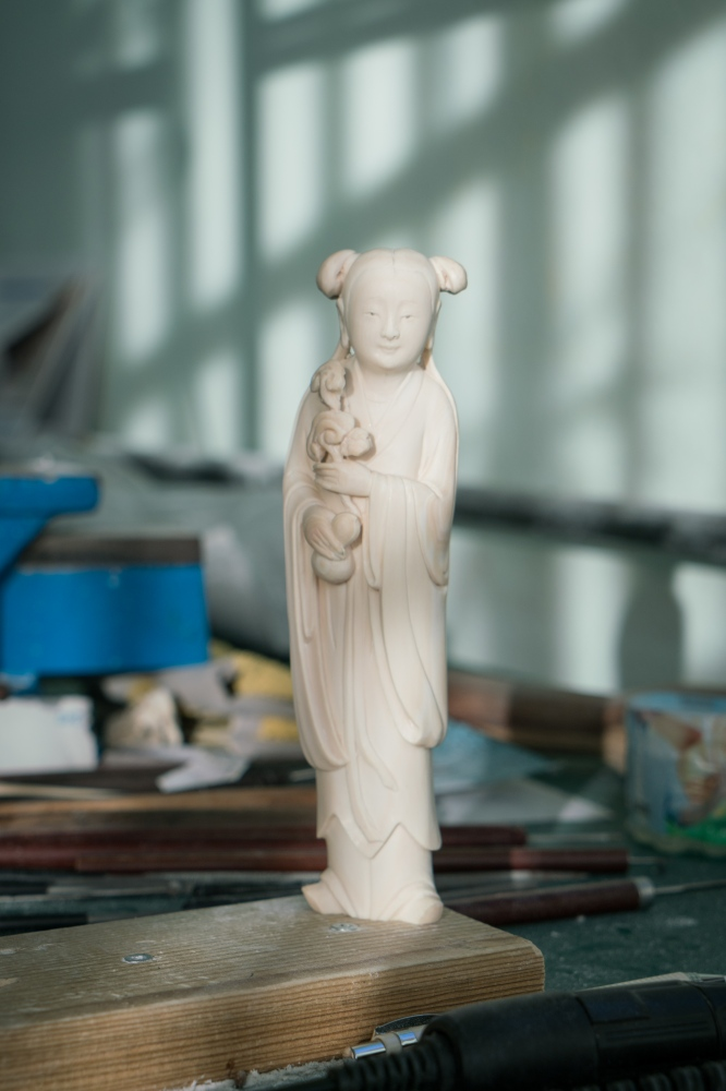 An unfinished ivory statue of Taoist goddess Magu, who represents longevity. Ivory carving artist Pan Xingjie has spent about a month working on this statue at Li Chunke's ivory carving workshop in Beijing, China on December 10, 2017.