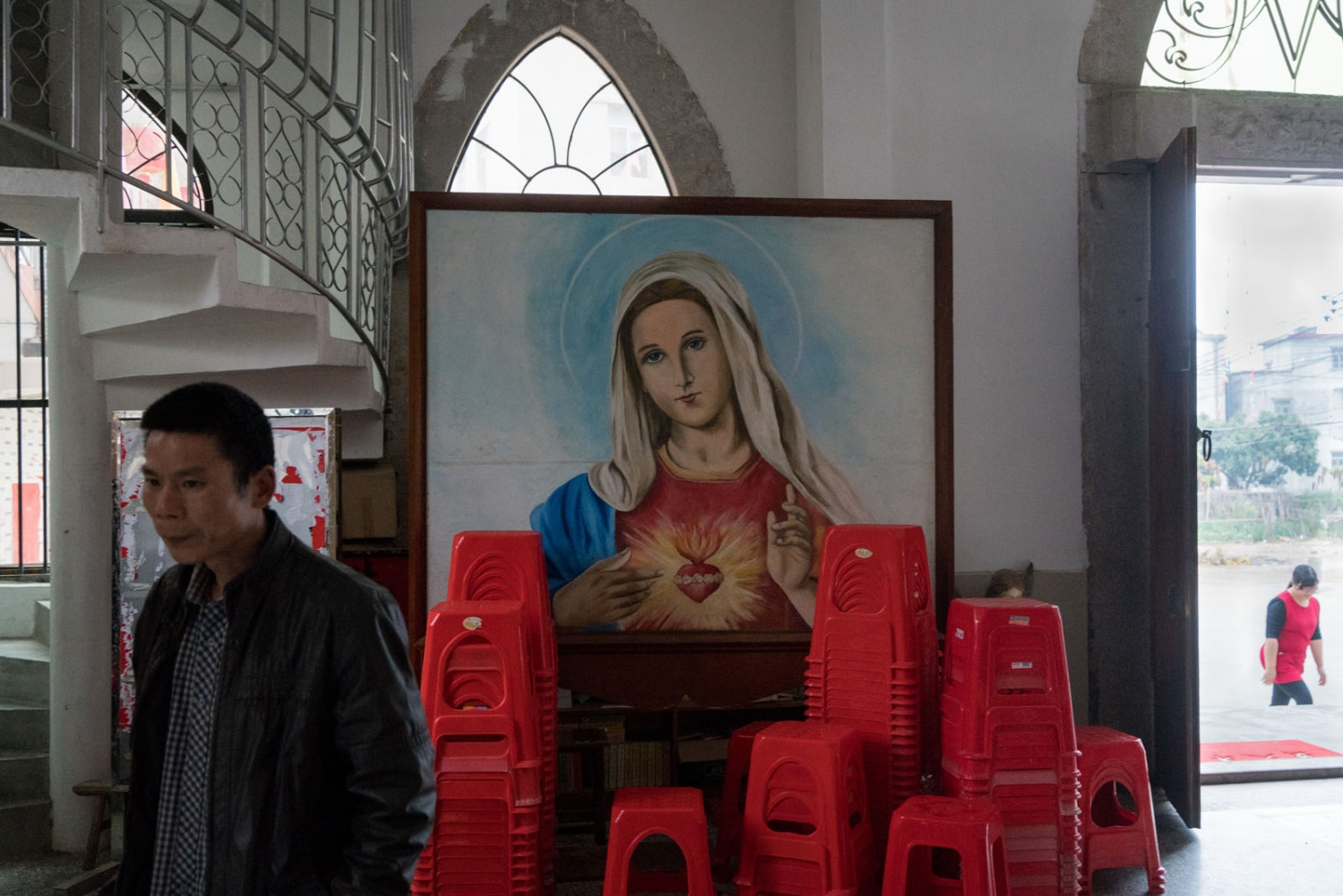 A man walks into Bobei Church before a prayer in Guangdong province, China on March 4, 2018.
