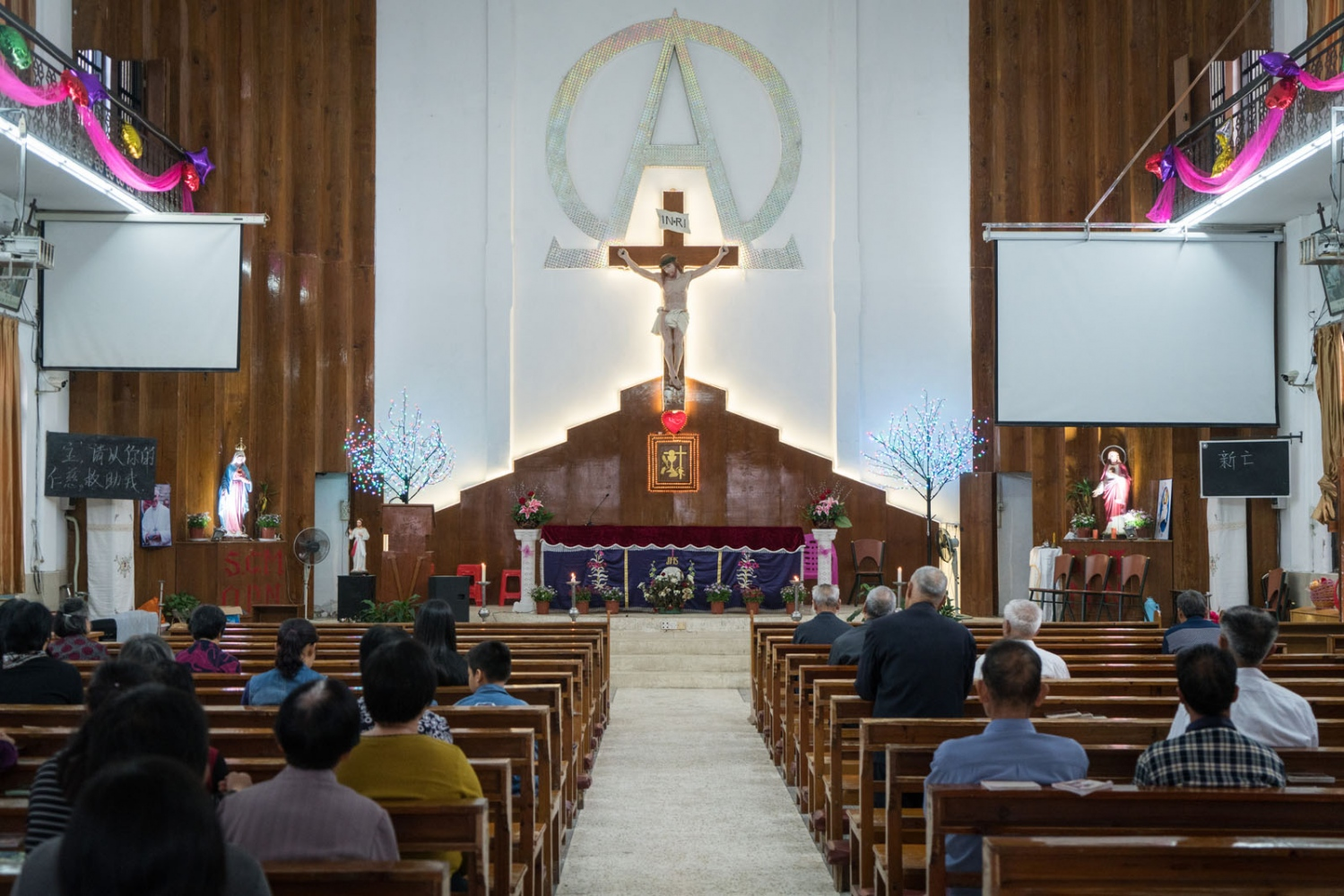 Catholics from nearby villages pray and chant in Bobei Catholic Church in Guangdong province, China on the morning of March 4, 2018.